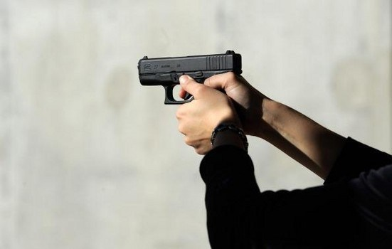 TUCSON, AZ - JANUARY 15:  Alexis Silva shoots her Glock 27 .40 caliber handgun at the Southwest Regional Park shooting range near the Crossroads of the West Gun Show at the Pima County Fairgrounds on January 15, 2011 in Tucson, Arizona. Today marks one week since Jared Lee Loughner killed six and injured several others, including U.S. Rep. Gabrielle Giffords (D-AZ), who he shot in the head with a 9-millimeter Glock semiautomatic pistol and who remains in critical condition. (Photo by Kevork Djansezian/Getty Images)